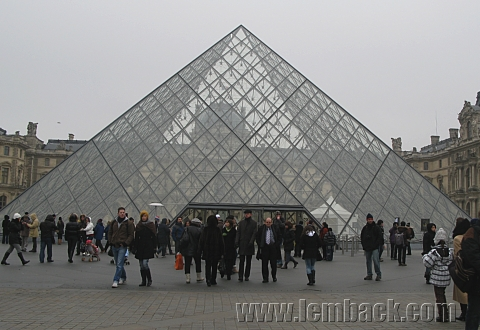 The Louvre Museum Pyramid among the crowds.